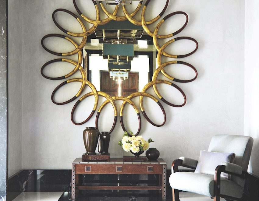 7 Secrets to Decorating with Wall Mirrors You Need To Learn ➤ Discover the season's newest designs and inspirations. Visit us at http://www.wallmirrors.eu #wallmirrors #wallmirrorideas #uniquemirrors @WallMirrorsBlog  Brass light fixture is reflected in a 1960s Italian mirror with a hand-carved frame 7 Secrets to Decorate with Wall Mirrors You Need To Learn 7 850x660
