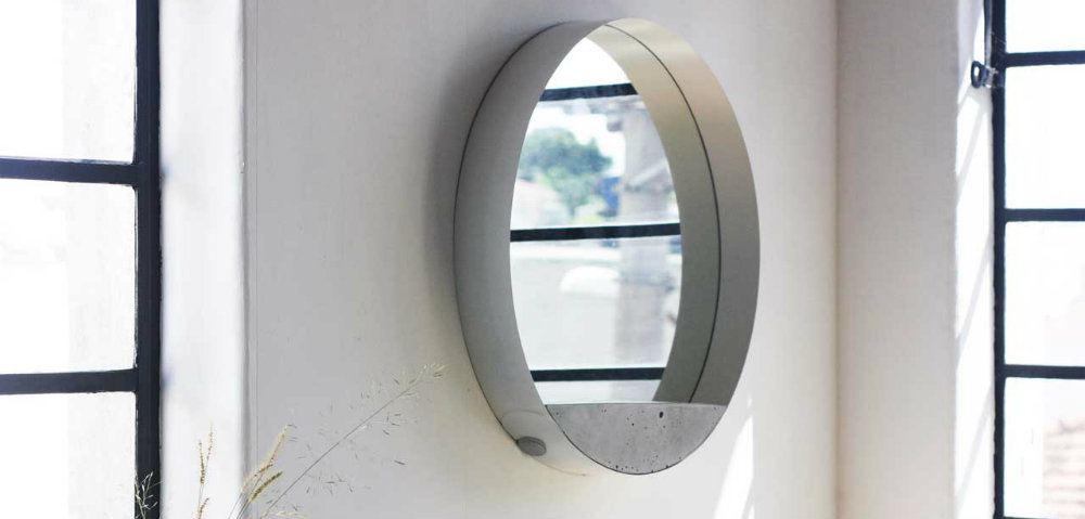 A different wall mirror composed by three materials